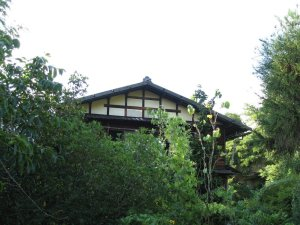 Japanese farmhouse surrounded by foliage