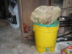 big stone on bucket.